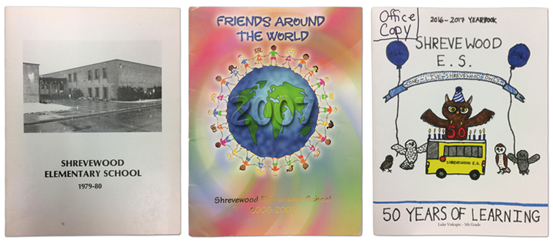 Shrevewood yearbook covers from 1979-1980, 2006-2007, and 2016-2017. The 1980 yearbook has a black and white image of the entrance to the school. The 2007 yearbook has a cartoon of children holding hands and encircling the Earth. The 2017 yearbook has the mascot owl celebrating the school's 50th anniversary with cake and balloons.
